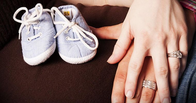 baby-shoes-mom-belly-maternity